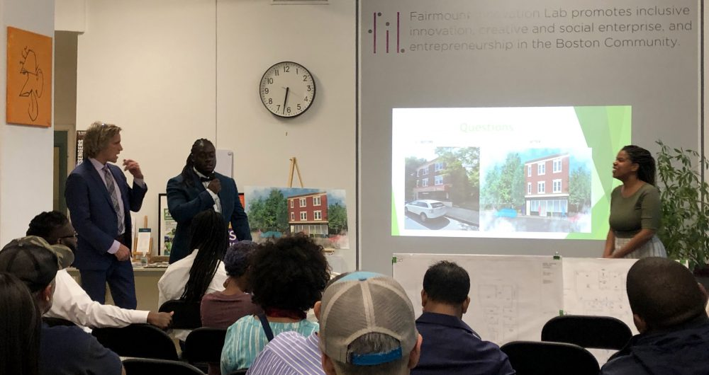 From left: Michael Maloney, Mark Bouquet and Vanessa Jean-Baptiste present their plan for Legal Greens LLC to an audience of Upham's Corner residents on Wednesday night. Photo by Eileen O'Grady.