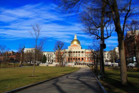 The Massachusetts state capitol building on beacon hill, taken from a distance in boston common
