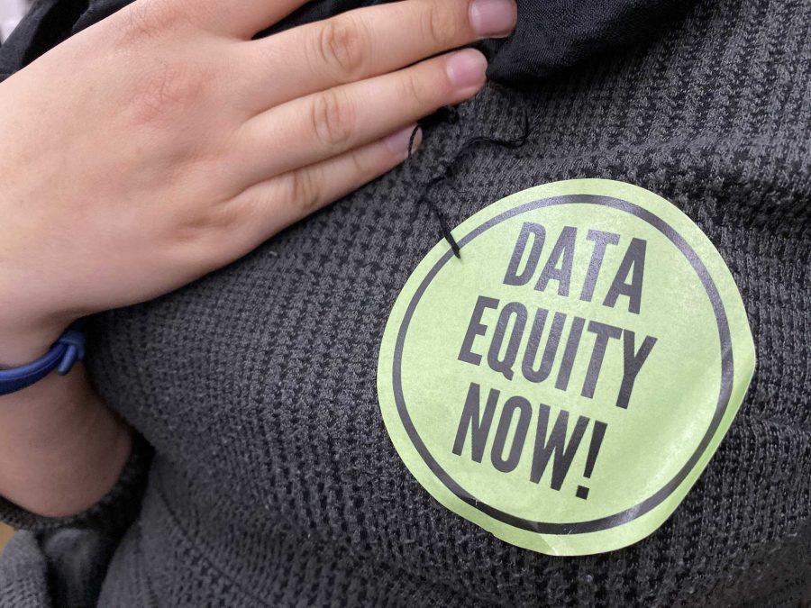 "Advocates sporting light green stickers that read ""Data Equity Now!"" said the bill would give representation to groups within the commonwealth. Photo by Alexa Gagosz."