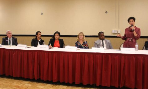 (From left to right) At-large City Councilor candidates, Councilor Michael Flaherty, Councilor Annissa Essaibi-George, Alejandra St. Guillen, Erin Murphy, David Halbert, Julia Mejia and Councilor Michelle Wu, met on Tuesday, Oct. 1 at Florian Hall to discuss voters' issues. Photo by Alexa Gagosz.