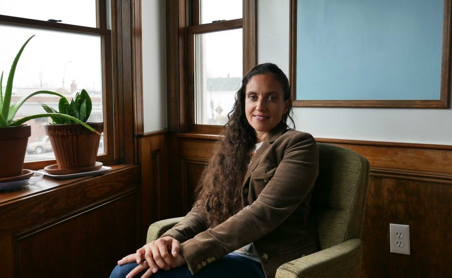 Magdalena Ayed, executive director of the Harborkeepers, sits in a conference room in her East Boston building. Photo by Jordan Erb.