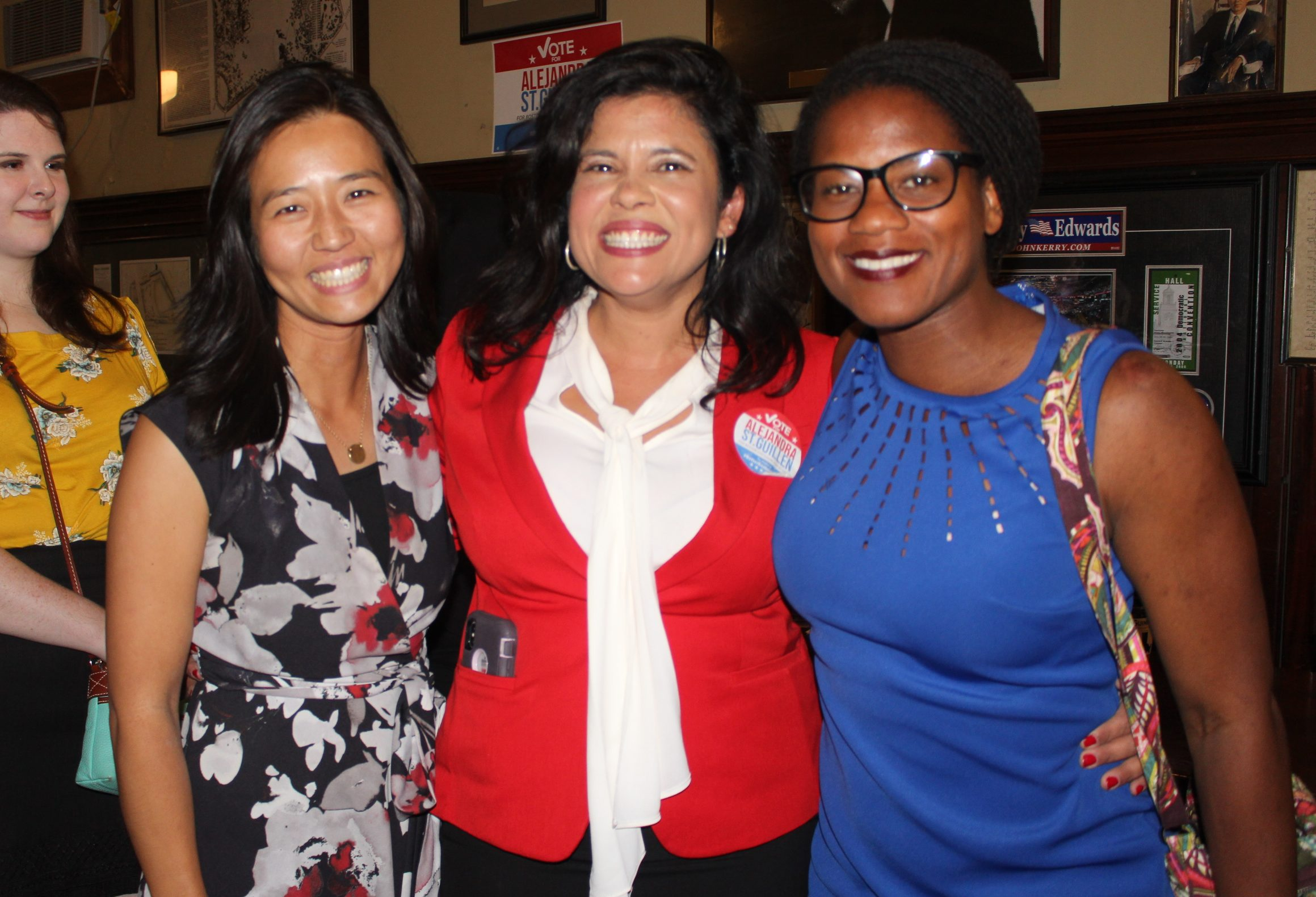 Alejandra St. Guillen (center) at her post-election party with fellow candidates Michelle Wu (left) and councilor Lydia Edwards (right). Photo by Alexa Gagosz.