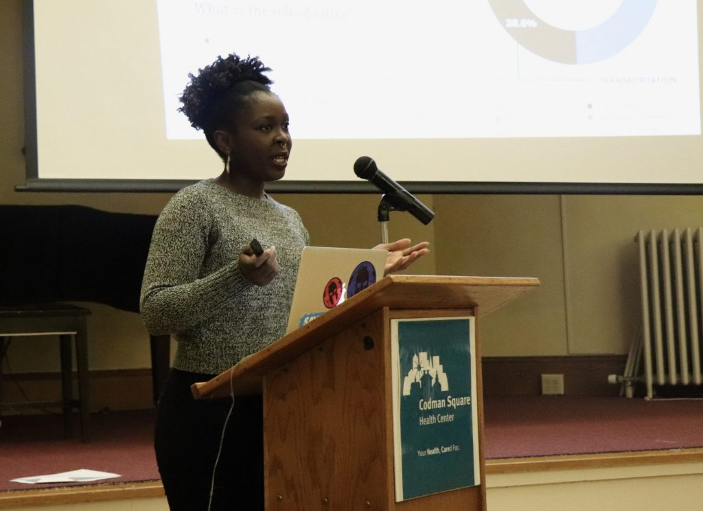 Sharon Amuguni, a facilitator of the discussion on climate change last week, speaking to the community members gathered at Codman Square Health Center. Photo by Eileen O'Grady.