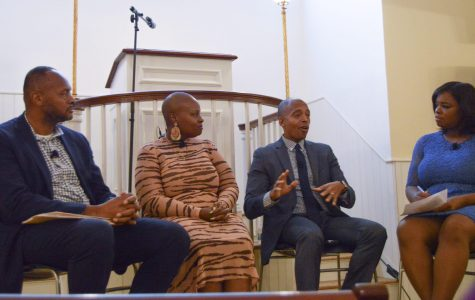 (Left to right) Michael Curry, Keeonna Harris, Khalil Muhammad and panel moderator, Tina Martin, discuss closing the gap between communities and policy makers. Photo by Bryan Tan.
