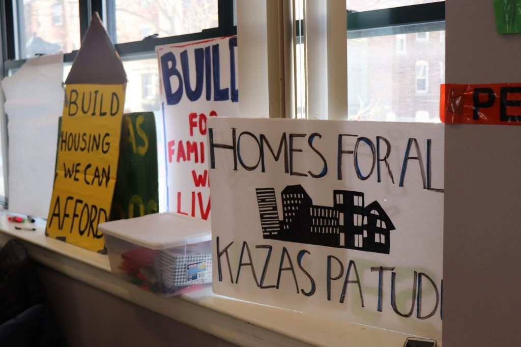 Protest signs at the people's assembly in Fields Corner. Photo by Eileen O'Grady.