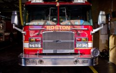A Boston Fire Department truck in a station. Photo by garghe, via Flickr, CC BY-SA 2.0.
