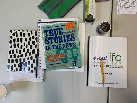 Student textbooks used in the classroom at Nueva Vida Christian Church. Rodríguez hopes to make more English language books available to the Latinx community. Photo by Maria Aguirre Torres.