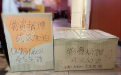 Boxes of surgical masks and medical supplies wait to be shipped from UMass Amherst to Wuhan China, in the fight to contain the coronavirus. Photo by Hiu Yan Ping.