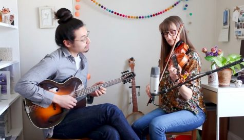 Boston musicians Ethan Setiawan and Louise Bichan record a video in their home for Club Passim's Keep Your Distance Festival.
