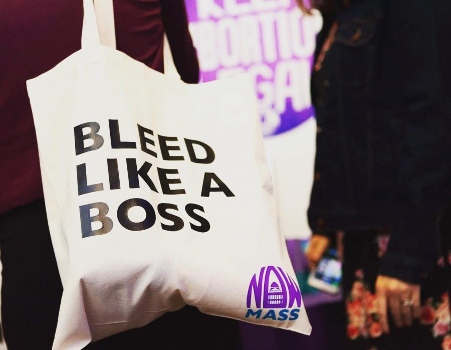 Mass+NOW+members+hand+out+these+bags+to+raise+awareness+about+period+poverty.