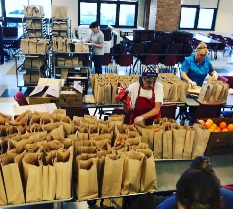 Project Bread volunteers work tirelessly to feed Boston residents facing food shortages during the pandemic.