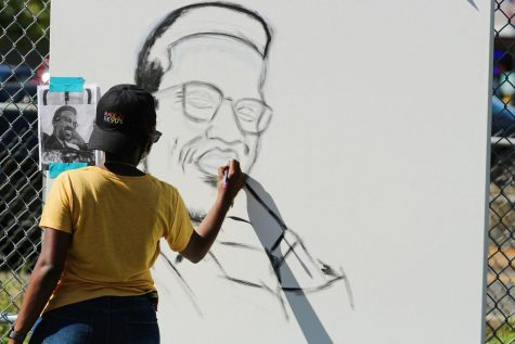 "It's been just about three years since Sophia Dubuisson, a UMass psychology senior, learned about Malcolm X.   ""I grew up in Haiti, and my school was honestly mostly European based,"" Dubuisson said as she worked on a portrait of Malcolm X on the baseball field at Town Field Park on Saturday. ""The most we heard about was MLK."""