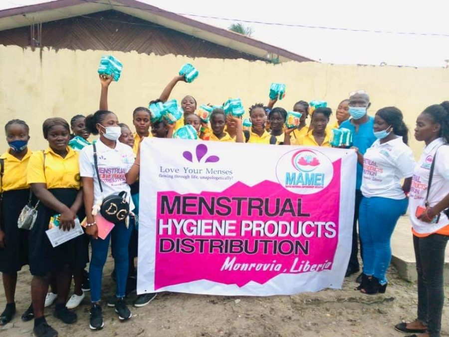 A group of girls in Liberia receiving care kits with menstruation products from 'Love Your Menses.' Photo courtesy: 'Love Your Menses.'