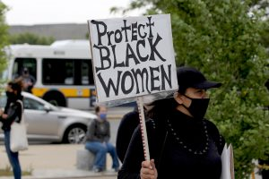 A Protect Black Women sign
