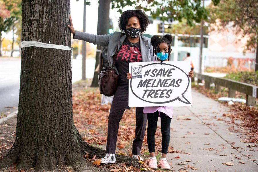 Boston city council president Kim Janey, and her granddaughter Rosie, at a protest Oct. 24, 2020, against the city's plans to remove more than 100 mature trees along Melnea Cass Blvd.