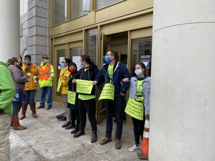 Protesters locking arms to block the entrance to Boston's Eastern Housing Court