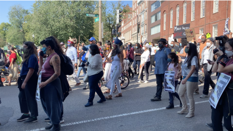 Protesters supporting Indigenous Peoples' Day heading to Boston Common from Park Street station.