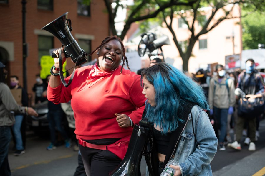 Two women dance with each other as they lead a march from Boston City Hall through the South End and to Lower Roxbury on June 7.
