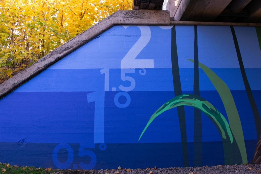 A mural painted underneath the Greenway's Sumner St. overpass illustrates how increasing global temperature will impact sea level rise.
