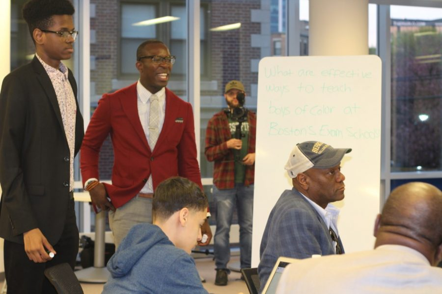 Gavin Smith (second from left) with his mentors and students at a Young Men Organizing for Change meeting