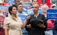 Tanisha Sullivan held the microphone for Congresswoman Ayanna Pressley as she delivered the keynote address from the steps at the corner of the Boston Common, near the intersection of Beacon and Park Streets.