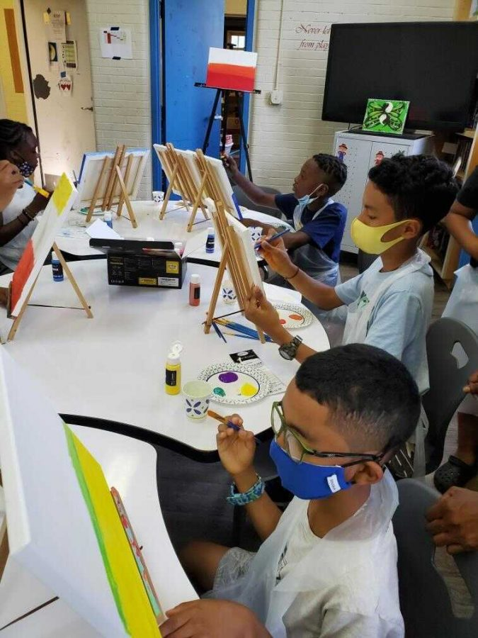 Children ages 9-13 painting at an art workshop offered by All Dorchester Sports and Leadership and Brain Arts Organization on July 24, 2021.