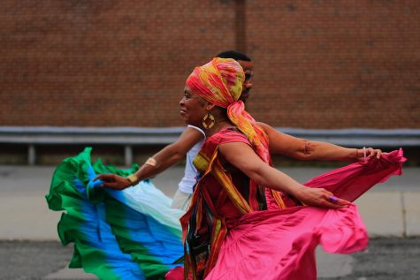 """Cultural performances during the Roxbury Unity Day parade deemed to be an eye-gazing experience. From the group leader, Isaura Oliveira: """" LIVING EXPERIENCE brought Power of Skirts to the streets for Roxbury Unity Parade 2021. Our skirts are choreographed by Isaura Oliveira, Brasil in partnership with Eli Pabon, Puerto Rico. We came by the beautiful effort of our dance students Olivia Hatten, Charles Murrell III, Cito Colòn, Melissa Huser Cherish Casey, Yyoyo Green, Devi Bayan, Santana DaGraca, Melissa Ros and our elder Queen Akila Stanley and many others who could not be in person. Grateful to my colleagues musicians brothers: Brazilian mestre de capoeira Deraldo Ferreira, master African Drummers Sory Diabate and Joh Camara accompanied of Tiemoko Camara(Joh"""