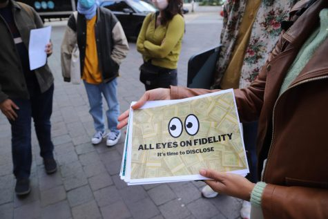 Members of Unmasking Fidelity coalition gather with signs and letter near Fidelity Investments' headquarters on September 30th, 2021.
